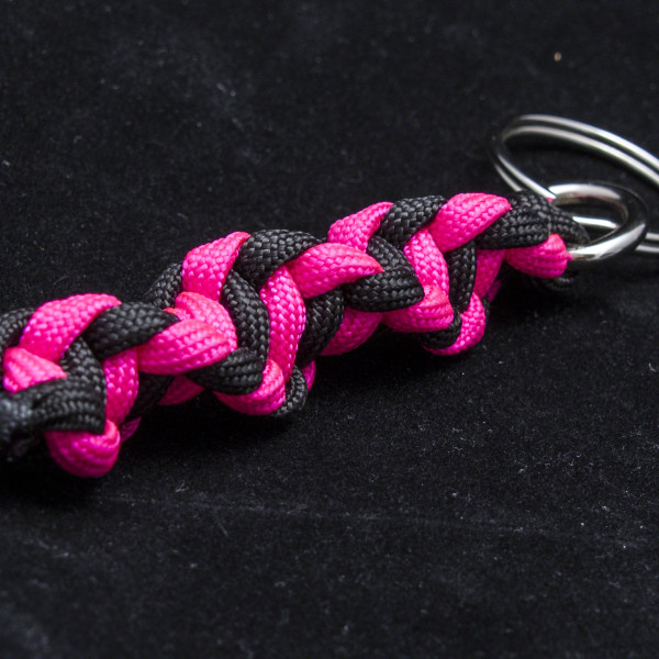 neon pink and black dna strand key chain how to knot me